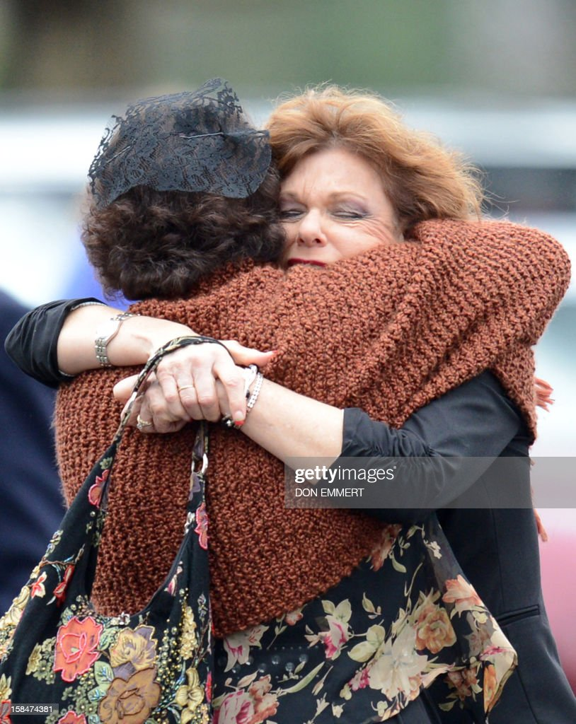 Veronika Pozner (Back to Camera) receives a hug as she leaves the funeral services of her six year-old son Noah Pozner, who was killed in the shooting massacre in Newtown, CT, at Abraham L. Green and Son Funeral Home on December 17, 2012 in Fairfield, Connecticut. Today is the first day of funerals for some of the twenty children and seven adults who were killed by 20-year-old Adam Lanza on December 14, 2012. AFP PHOTO / Don EMMERT
