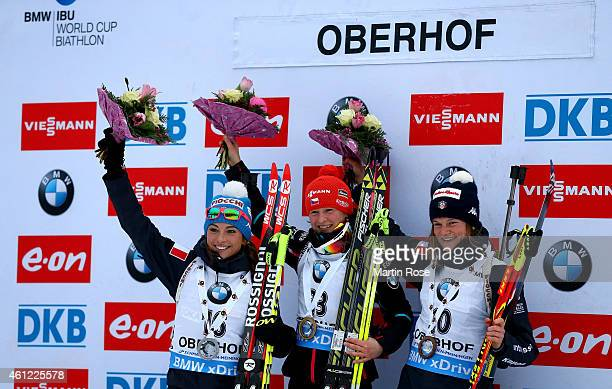 Veronika Vitkova of Czech Republic poses on the podium with second placed Dorothea Wierer of Italy and third placed Nicole Gontier of Italy after the...