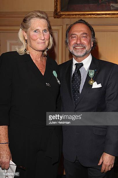 Veronique Andre poses with Olivier Dassault after being awarded of 'French Order of Chevalier des Arts and Literature' at Hotel George V on December...