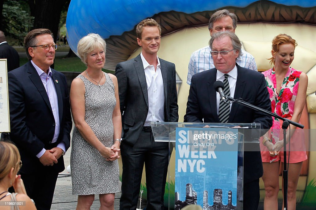 Veronique Culliford, Neil Patrick Harris and Jayma Mays (R) look on as NYC & Company CEO George Fertitta speaks at the New York Smurf Week kick off ceremony at Smurfs Village at Merchant's Gate, Central Park on July 25, 2011 in New York City.