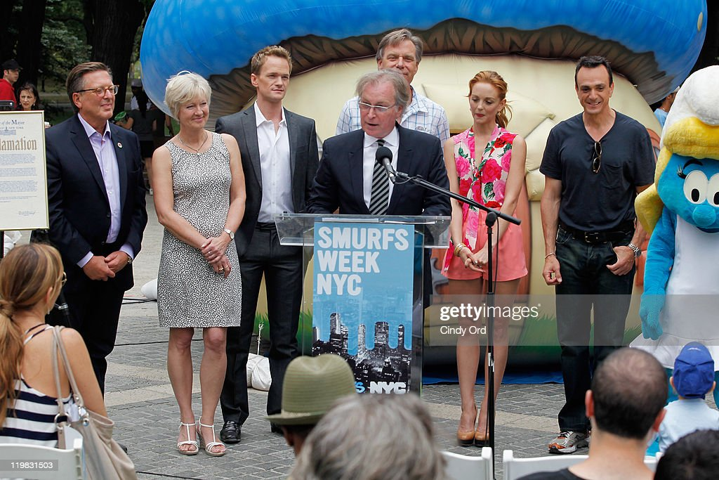 Veronique Culliford, Neil Patrick Harris, Jayma Mays and Hank Azaria look on as NYC & Company CEO George Fertitta (C) speaks at the New York Smurf Week kick off ceremony at Smurfs Village at Merchant's Gate, Central Park on July 25, 2011 in New York City.