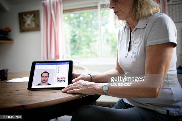 Veronique de la Brelie shows a robot portrait of a suspect on a tablet after her horse Cimona has been attacked on July 9, at her property, in...