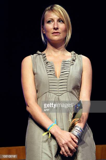 Veronique De Viguerie of Paris Match/Getty Images receives a trophy on Octobrer 9, 2010 in Bayeux, western France, after winning the photo award for...