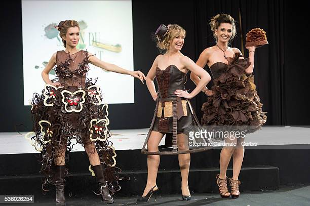 Veronique Mounier Louise Ekland and Adeline Blondieau walk the runway during the 'Salon Du Chocolat' Fashion Show on October 29 2014 in Paris France