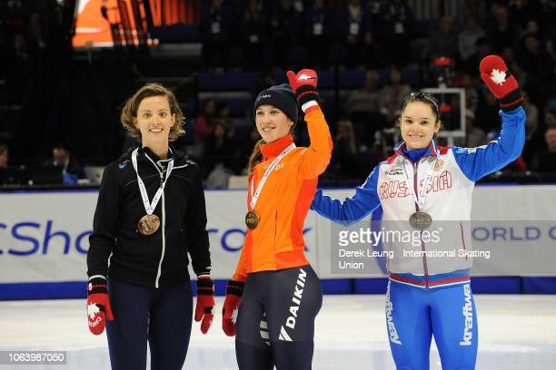 Veronique Pierron of France Suzanne Schulting of the Netherlands and Sofia Prosvirnova of Russia pose for a photo after placing in the women's 1000m...