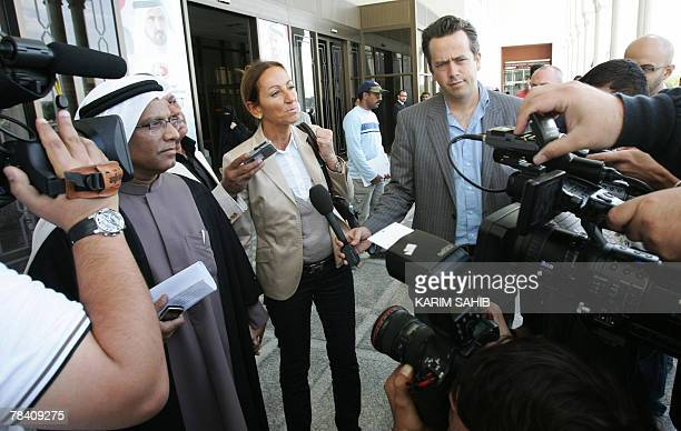 Veronique Robert mother of a 15yearold FrenchSwiss teenager speaks to reporters after getting out of a courtroom with lawyer Hussein Ali following...