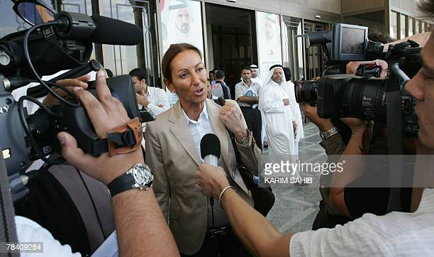Veronique Robert mother of a 15yearold FrenchSwiss teenager speaks to reporters following the trial of two of three Emirati nationals accused of...