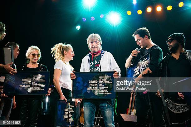 Veronique Sanson Renaud Grand corps malade and Lino are receiving a reward on stage at Le Trianon on June 17 2016 in Paris France
