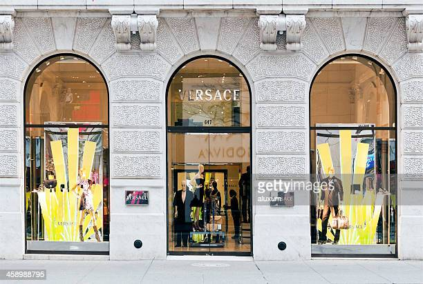 versace in the fifth avenue new york - versace designer label stock photos and pictures
