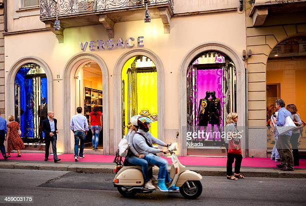 versace store - milan, italy - versace designer label stock photos and pictures