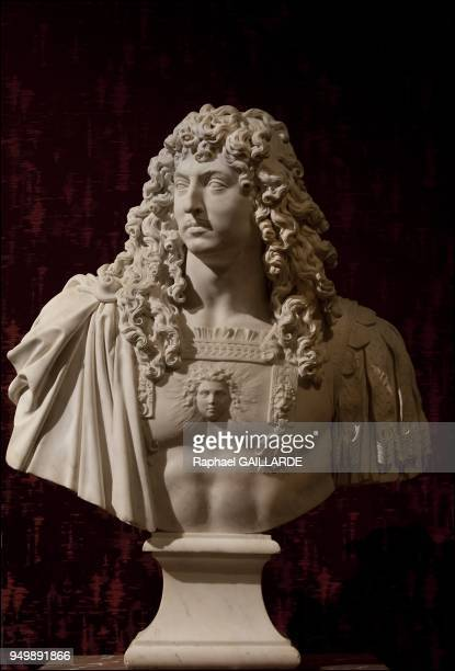 Versailles and the Classic ArtLouis XIV marble statue by Antoine Coysevox 1681 on November 12 2012 in Versailles France