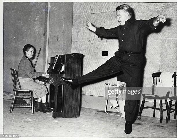 Versatile actor Jimmy Cagney rehearses some Irish steps in Dublin accompanied by local pianist Julia Grey She interrupted her regular job running a...