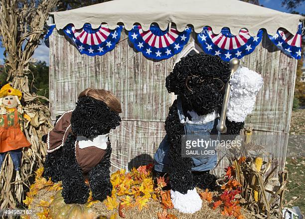 Versions of Bo and Sunny the First Family's dogs dressed as the characters from the 'American Gothic' painting appear on the South Lawn of the White...