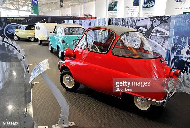 Versions of various BMW Isetta 'Bubble Cars' sit on display at the Zentrum visitors center part of the company's BMW Manufacturing Co plant in...