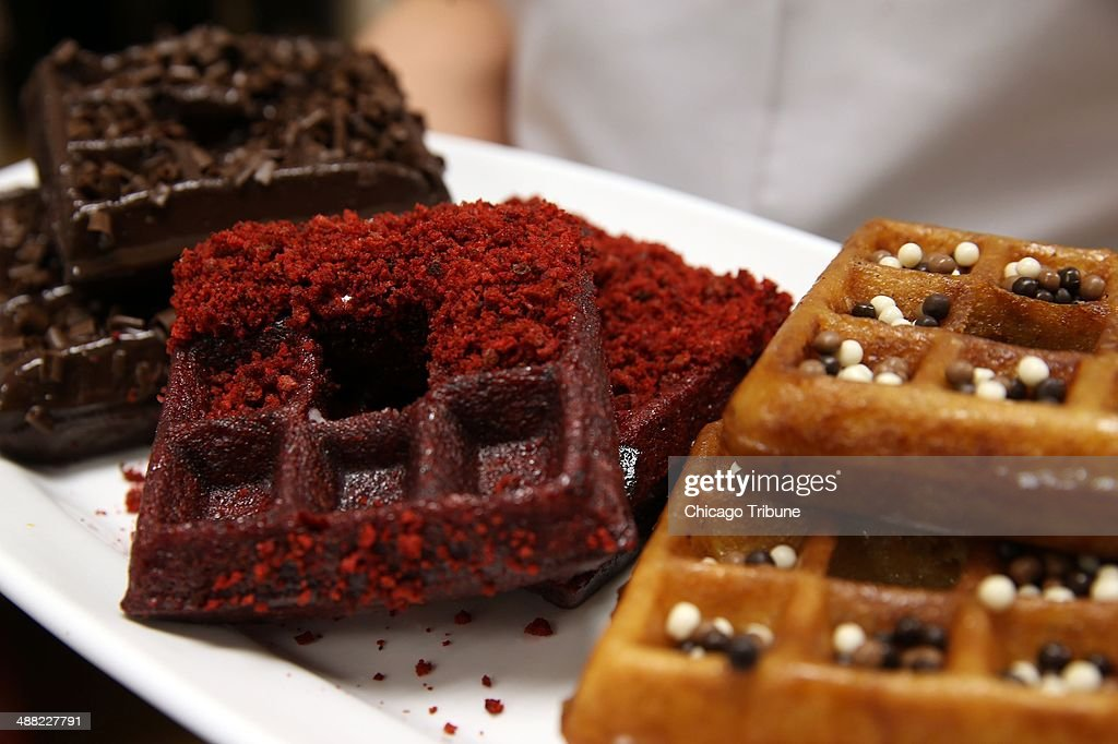 Versions of 'wonuts,' a cross between a donut and a waffle, are displayed at Waffles Cafe in Chicago on Monday, April 28, 2014. Left to right: Mexican chocolate, red velvet, and tiramisu.