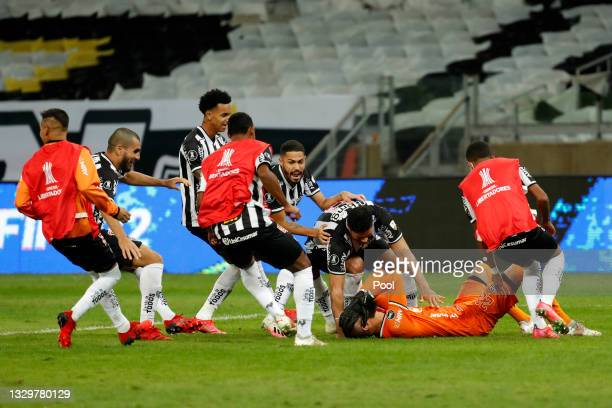 Éverson of Atletico MG celebrates with teammates after scoring a penalty in the shootout qualifying their team to the next round after a round of...