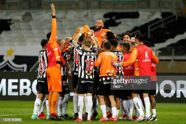 Éverson of Atletico MG celebrates with teammates after scoring the last penalty in the shootout qualifying their team to the next round after a round...