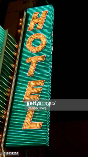 vertical hotel sign - lyn holly coorg stock pictures, royalty-free photos & images