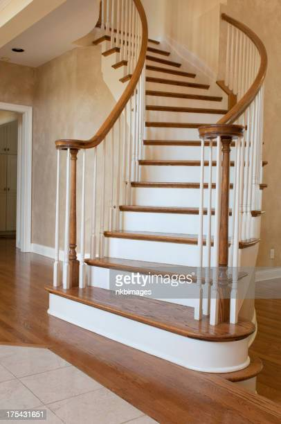 Vertical image of a curved entryway staircase