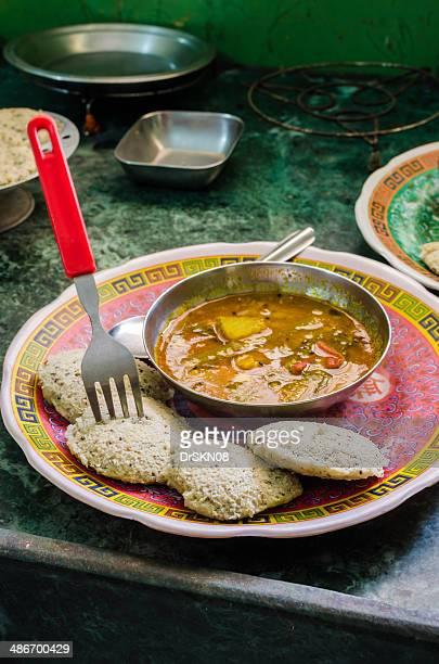 Vertical image of Indian snacks Idli- Sambhar