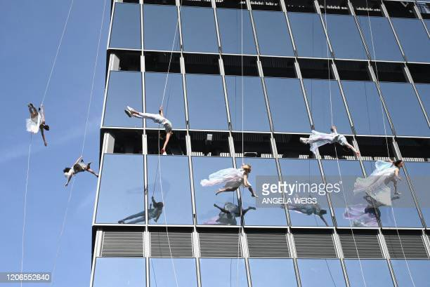 Vertical performers BANDALOOP perform at the opening of Edge the Western Hemisphere's highest outdoor sky deck in New York City on March 11 2020 Edge...