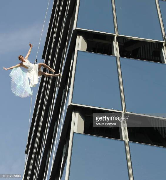 Vertical performers BANDALOOP put on a spectacular show at the opening of Edge the Western Hemisphere's highest outdoor sky deck in New York City NY...
