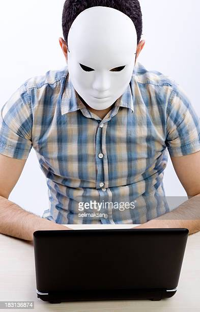 Vertical Photo Of Man With Mask Using Computer For Hacking