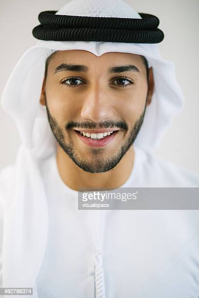 Vertical Portrait of Young Arab Man Dressed in Traditional Clothing