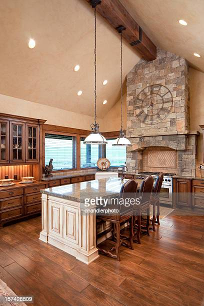 Vertical shot of a natural tone kitchen with island