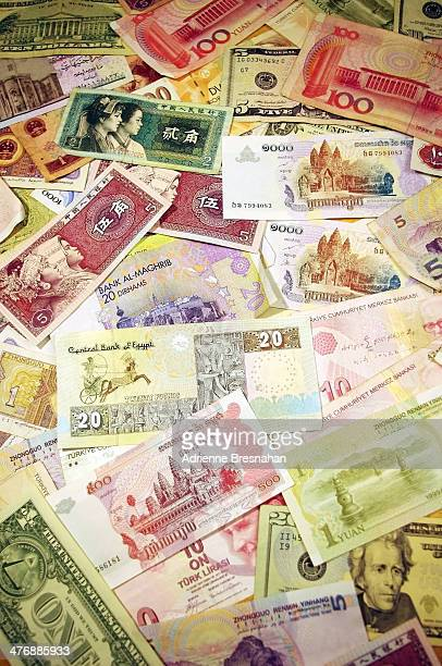 CONTENT] Vertical shot of a variety of banknotes in different denominations from around the world Countries represented include the United States of...