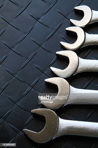vertical spanner wrenches - endopack stock pictures, royalty-free photos & images