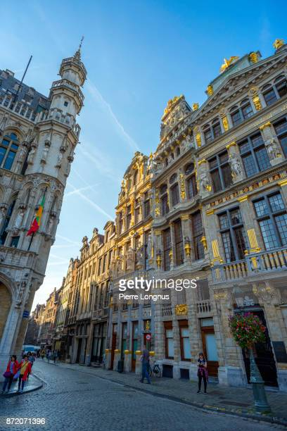 Vertical - Sunset light on the facades and entrance of the 'Rue de la Tête d'Or' (English : Golden Head Street) from The Grand Place, UNESCO World Heritage Site, Brussels, Belgium
