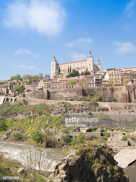 Vertical view of Alcazar Castle and walls of Toledo from the Tagus River.