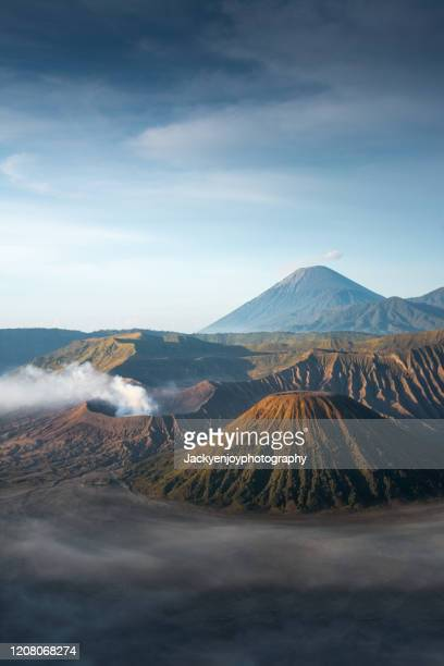 vertical view of beautiful landscape of mount bromo during sunrise in bromo tengger semeru national park, east java, indonesia - bromo crater stock pictures, royalty-free photos & images