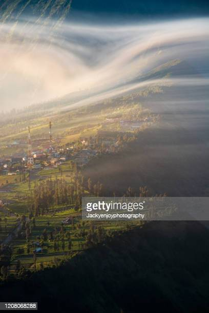 vertical view of cemoro lawang village at mount bromo, indonesia - bromo crater stock pictures, royalty-free photos & images