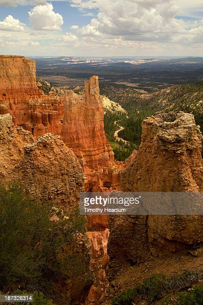vertical view of hoodoo formations; road beyond - timothy hearsum stock pictures, royalty-free photos & images