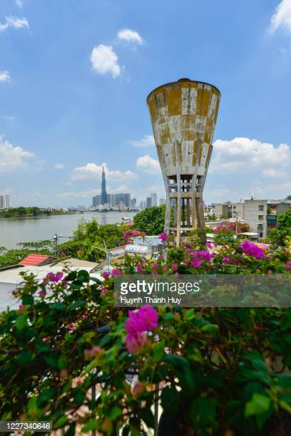 vertical view of old water tower and landmark 81 building - saigon river stock pictures, royalty-free photos & images