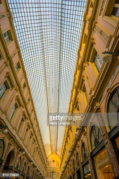Vertical view of the glass-roofed of Galeries Royales Saint-Hubert, one of Arcade galleries in Brussels, Belgium
