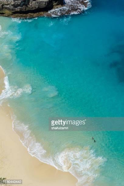 vertiginous, swirling foamy water waves at the ocean photographed from above cliff. - shaifulzamri bildbanksfoton och bilder