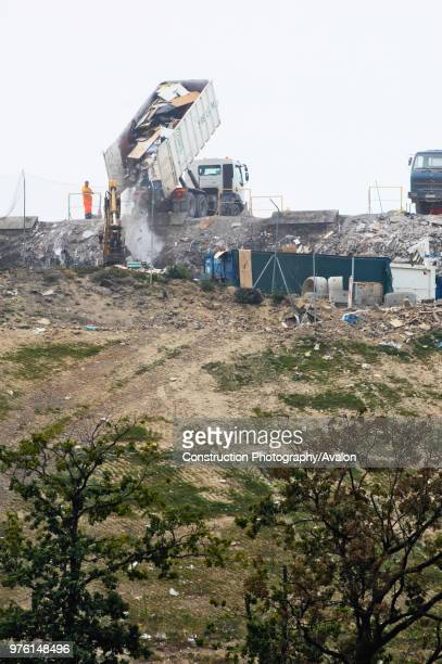 Vertle Grand Essonne France lorry unloading rubbish at landfill site
