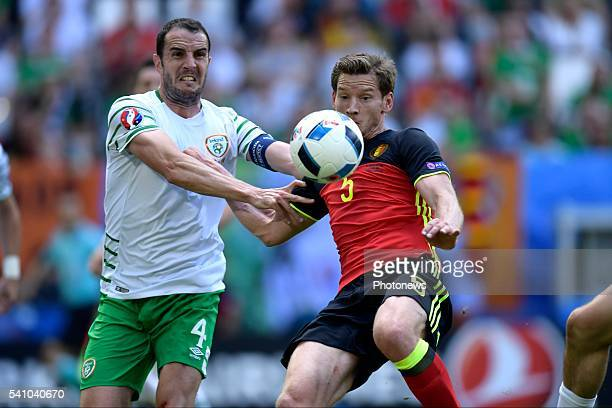 Vertonghen Jan defender of Belgium is fighting for the ball with O'Shea John defender of Republic of Ireland during the UEFA EURO 2016 phase final...