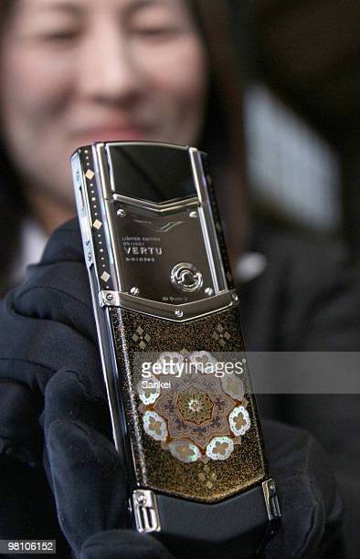 "Vertu employee displays their new mobile phone ""Kinko"" at the press preview on March 25, 2010 in Tokyo, Japan. Luxury mobile phone manufacturer Vertu..."