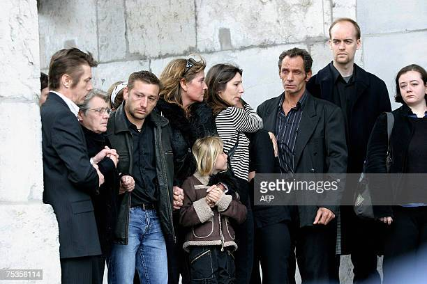 Unidentified relatives of the victims are pictured during the funeral of Chantal Charron and her twelve year old son Brian 10 July 2007 at the...