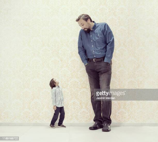 very big and very small - dwarf man stock pictures, royalty-free photos & images