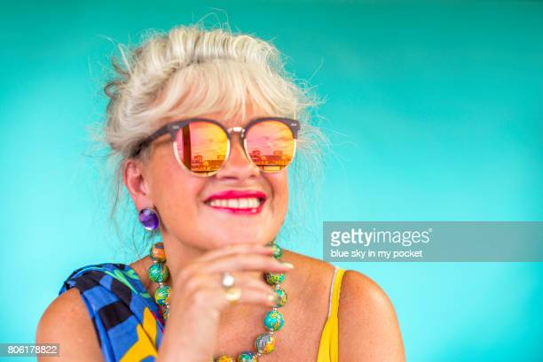 a very bright 66 year old senior lady. - focus on background stock pictures, royalty-free photos & images