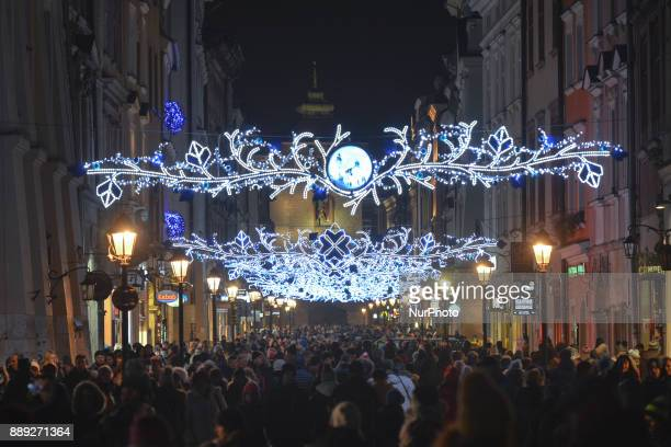 A very busy Krakow's Florianska Street that leads to the Christmas Market in the Main Square with thousands of locals and visitors from abroad On...