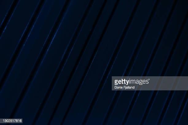 very dark blue painted surface with diagonal lines - dorte fjalland fotografías e imágenes de stock