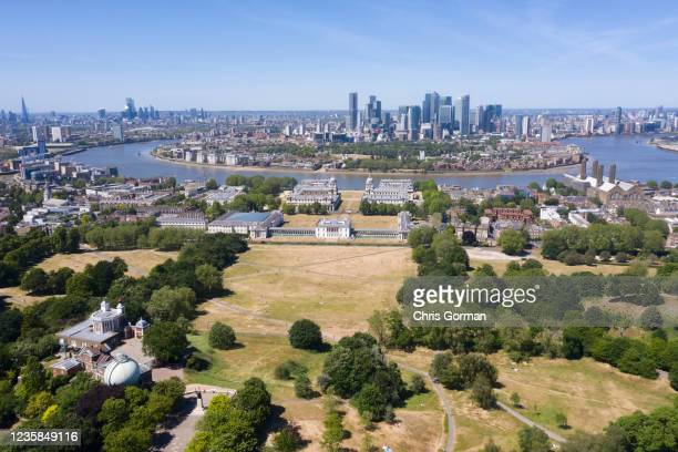 Very dry Greenwich Park sits beside the Isle of Dogs in this image by drone on May 29, 2020 in Greenwich, London.