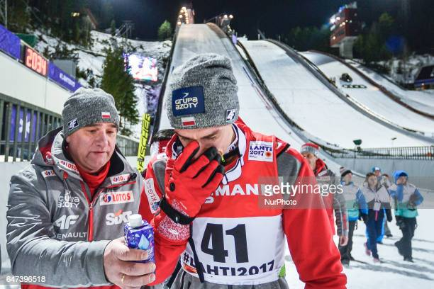 Very emotional Piotr Zyla from Poland after the Award Ceremony as he takes third place in Men Large Hill Individual final in ski jumping, at FIS...