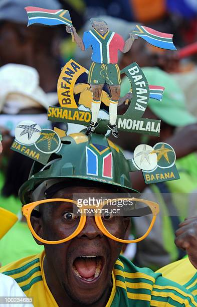 A very excited Bafana Bafana fan over joyed to be at Soccer City in Soweto on May 22 2010 wears a makarapa during a local soccer game The match is...